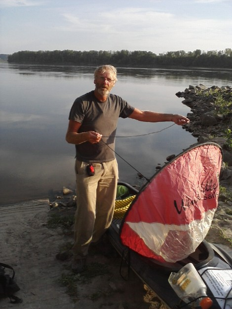 Bob Bellingham showing me his sail when laying over at Cooper's Landing.  The sail is now mine.