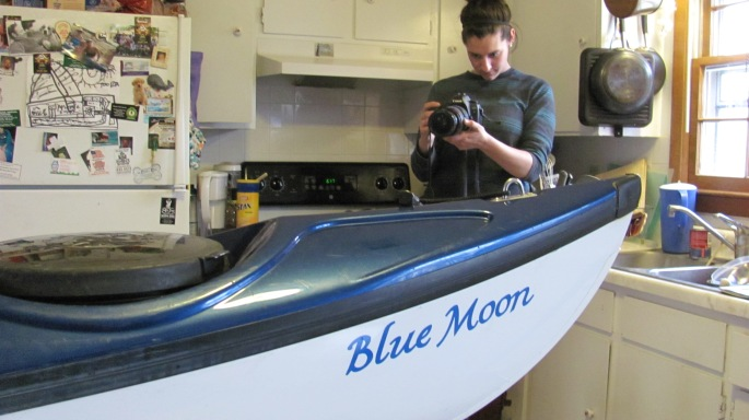 Megan May getting shots for her video story.  Here, we applied the new name to the boat in the house since the temps outside were too cold.