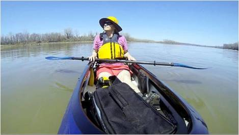 Janet Moreland floats down the Missouri River on Sunday. Moreland leaves for her 2,600 mile kayak trip on April 14 from the source of the river in Montana to St. Louis. The trip will take her three and a half months.