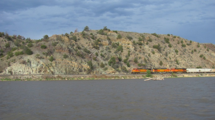 The train was fun to watch as it rolled right along lake's edge.