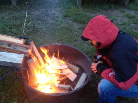 Despite the rainy and wet conditions, we made a fire for warmth and comfort. Thanks to the campers next door who helped me haul their leftover wood over, chopped kindling, and wrapped paper up in plastic for me. And, gave me a lighter!  So nice!