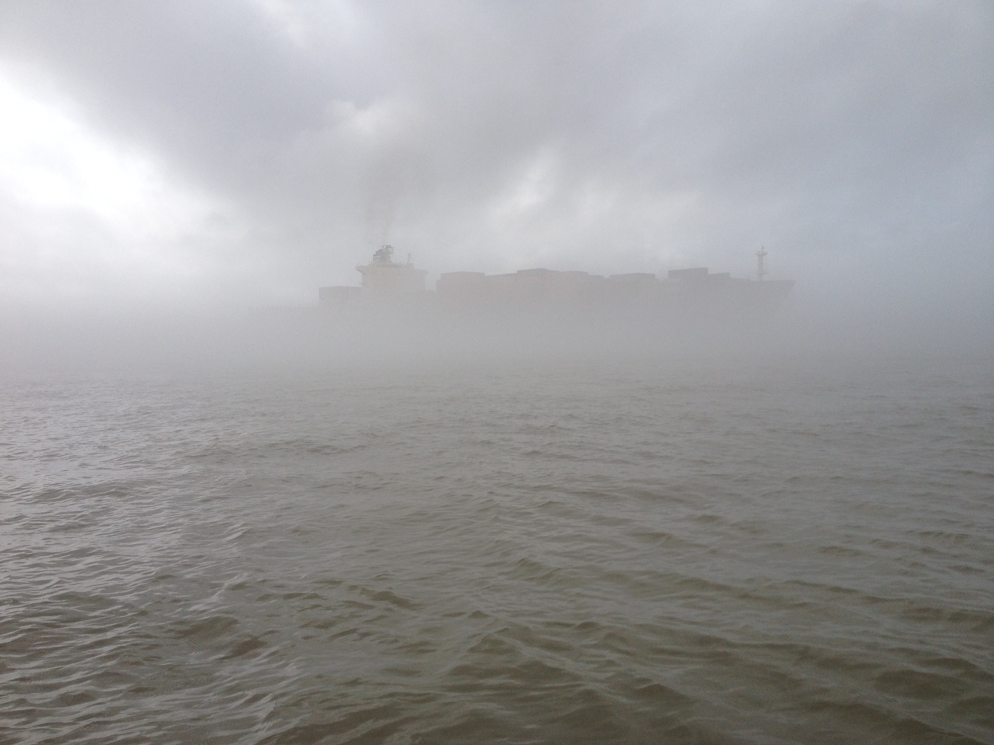 Ship approaching in the fog.